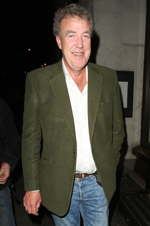 Jeremy Clarkson outside the Wosley trying to have a cigarette, except a homeless man was giving him a very hard time, eventually Jeremy gave up and went back inside and later left by the back door. London, England