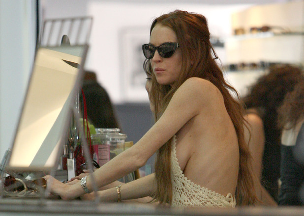 Lindsay Lohan shopping at 'Positive Eye Ons Optometry' on Melrose Avenue with her sister. Lohan appears to have lost weight after reportedly splitting from girlfriend Samantha Ronson West Hollywood, California