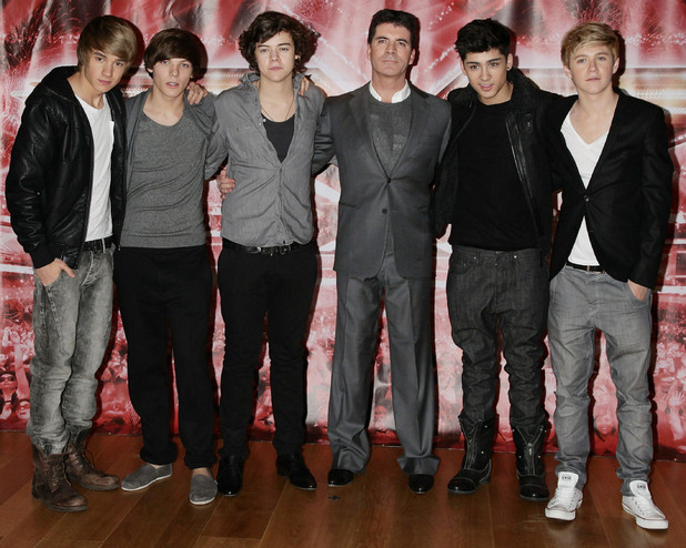Simon Cowell with One Direction (from left) Liam Payne, Louis Tomlinson, Harry Styles, Zayn Malik and Niall Horan attending a press conference for X Factor, at The Connaught Hotel in central London.