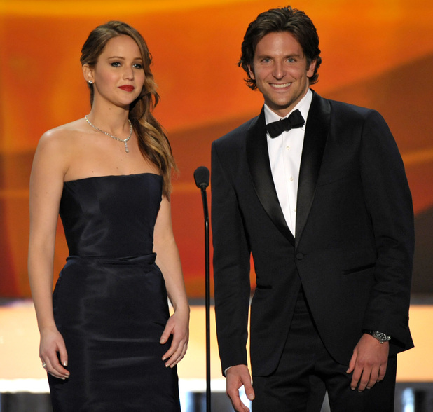 Jennifer Lawrence, left, and Bradley Cooper appear on stage at the 19th Annual Screen Actors Guild Awards at the Shrine Auditorium in Los Angeles on Sunday Jan. 27, 2013. (Photo by John Shearer/Invision/AP)