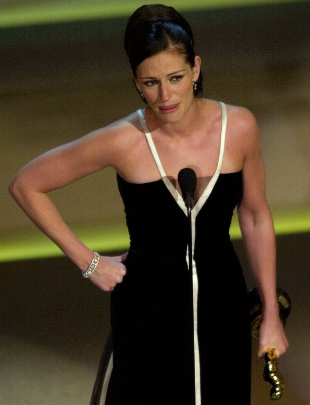 "Julia Roberts appears emotional as she accepts the best actress Oscar for her role in ""Erin Brockovich"" at the 73rd annual Academy Awards Sunday, March 25, 2001, in Los Angeles."