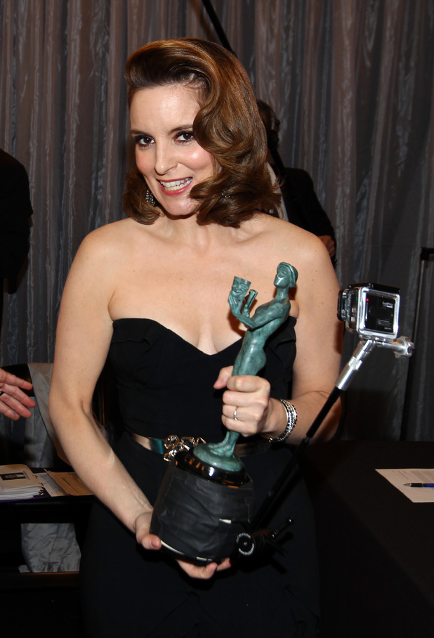 Tina Fey is seen backstage with the award for outstanding female actor in a comedy series for '30 Rock' in the press room at the 19th Annual Screen Actors Guild (SAG) Awards