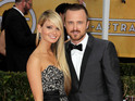 Breaking Bad's Aaron Paul marries Lauren Parsekian in Parisian-themed wedding.