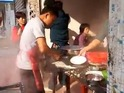 A street vendor in China dolls out hot food at an incredible rate.