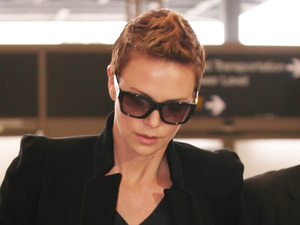 Charlize Theron, dressed in all black, arrives at Los Angeles International airport (LAX) to catch a flight Featuring: Charlize Theron Where: Los Angeles, California, United States When: 07 Feb 2013