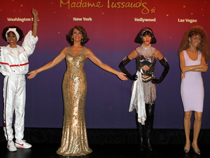 Madame Tussauds unveils four wax figures of Whitney Houston, immortalizing memorable moments in her career