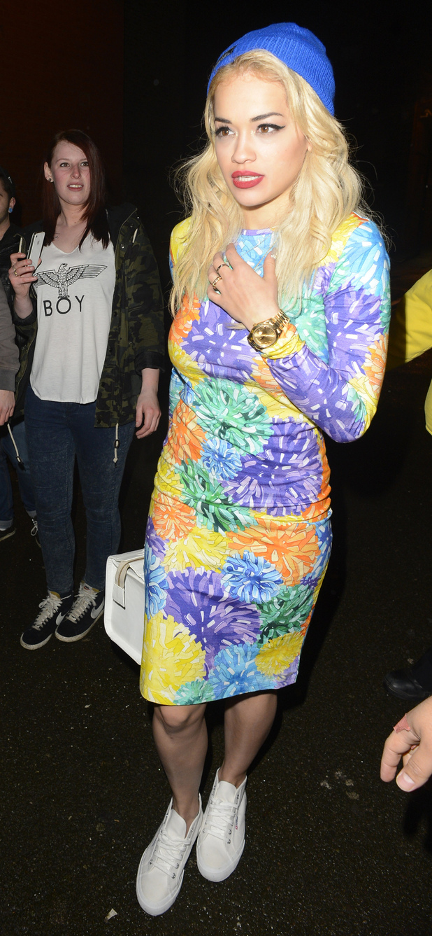 Rita Ora is surrounded by security as she leaves her gig at the Shepherd's Bush Empire