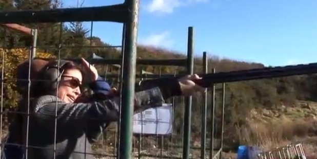 Melanie Sykes trying her hand at clay pigeon shooting with Peter Wilson.