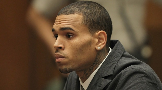 Chris Brown appears in court for a probation progress report hearing on February 6, 2013 in Los Angeles