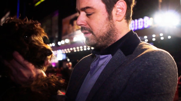 Danny Dyer being interviewed by Coco the dog at the Run for Your Wife premiere