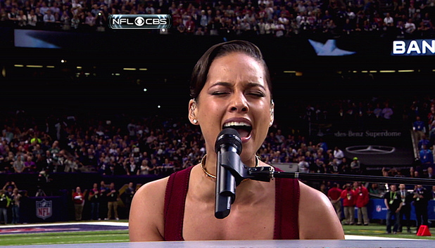 "Alicia Keys performs ""The Star-Spangled Banner"" while playing piano during Super Bowl XLVII, held at Mercedes-Benz Superdome in New Orleans, Louisiana."