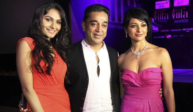 "Kamal Haasan, center, poses with Bollywood actresses Andrea Jeremiah, left, and Pooja Kumar during a press conference of his latest movie ""Vishwaroop"""