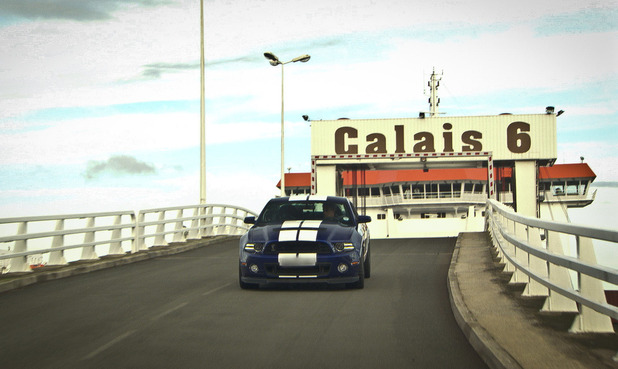 Top Gear - 10/02/2013 - Episode 3: Jeremy Clarkson driving a Ford Mustang GT600 with 'Calais 6' sign in the background