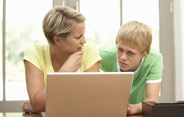 Mother and daughter using tablet computer