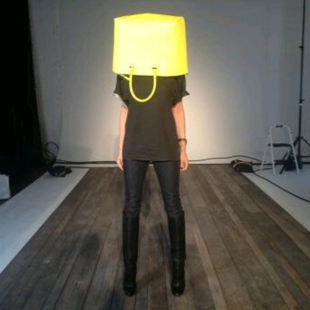 Victoria Beckham goes delirious at New York Fashion Week and wears a bag on her head