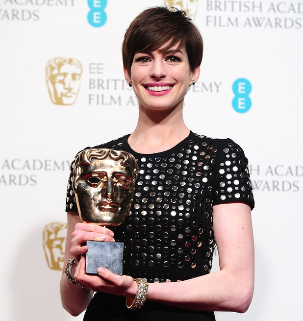 BAFTA 2013: Anne Hathaway with the award for Best Supporting Actress for 'Les Miserables'.