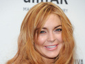 Lindsay Lohan's guest shot on Charlie Sheen show reportedly goes smoothly.