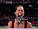 Keys sings slow rendition of National Anthem at sporting event.