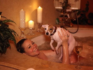 Mariah Carey in bubble bath with dog