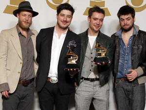 Ted Dwane, Marcus Mumford, Ben Lovett and Winston Marshall of the band Mumford & Sons pose backstage with the best long form music video award for &#39;Big Easy Express&#39; and the album of the year award for &#39;Babel&#39; at the 55th Annual Grammy Awards