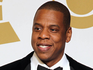 Jay-Z poses backstage with the awards for best rap/sung collaboration for 'No Church in the Wild' and best rap performance for 'N****s in Paris' at the 55th Annual Grammy Awards