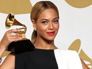 Beyonce poses backstage with the award for best traditional R&B performance for 'Love on Top' at the 55th Annual Grammy Awards