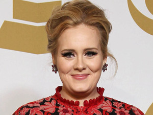 Adele poses backstage with the award for best pop solo performance for 'Set Fire to the Rain' at the 55th Annual Grammy Awards
