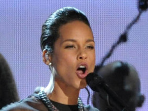 Alicia Keys plays the drums at the 2013 Grammy Awards