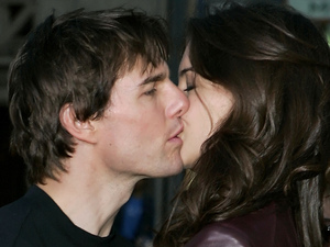 Tom Cruise and Katie Holmes kiss at the 'War Of The Worlds' film premiere after arriving on a motorcycle in 2005