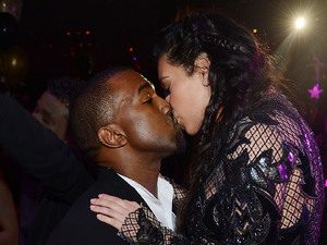 Kanye West and Kim Kardashian share a New Years kiss during the countdown at 1 Oak Nightclub, The Mirage, Vegas