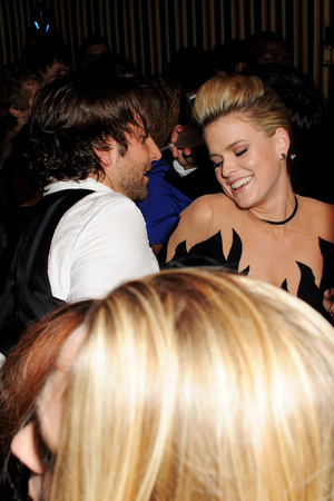 Bradley Cooper and Alice Eve dance together at a BAFTAs after party