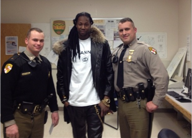 2 Chainz poses with police after arrest