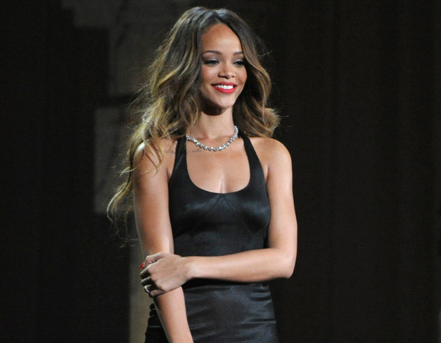 Rihanna performs on stage at the 55th annual Grammy Awards