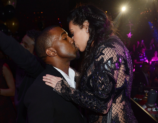 Kanye West and Kim Kardashian share a New Years kiss