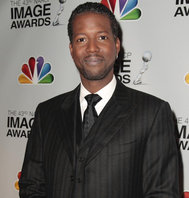 Corey Reynolds arrives at the nominations for the 43rd NAACP Image Awards.