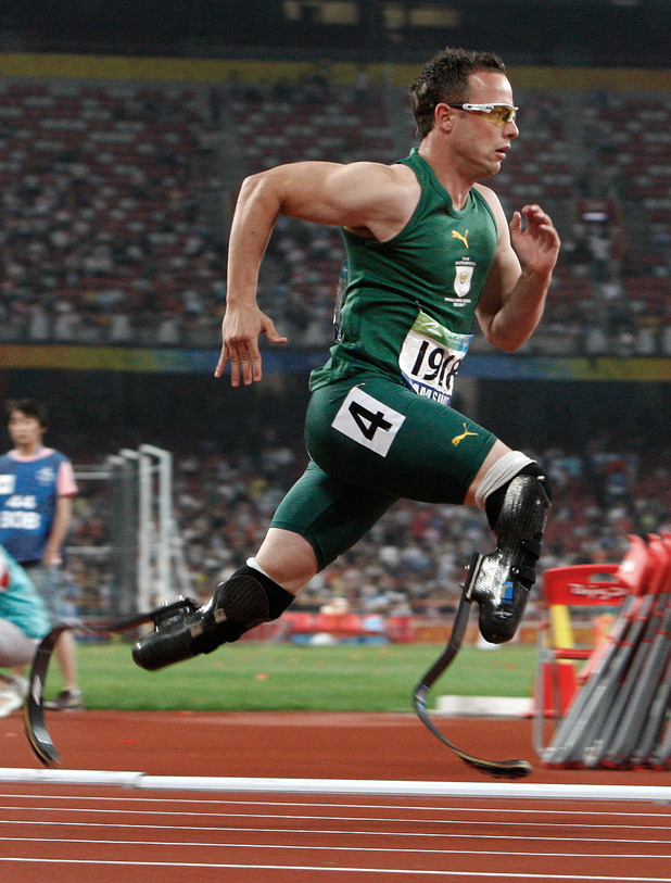 South Africa's Oscar Pistorius celebrates winning the men's T44 400m Final in the National Stadium, in Beijing, China.