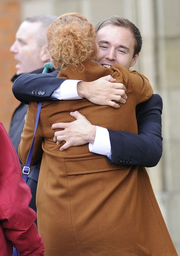 Tyrone and Fiz embrace at the end of the case