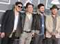 Mumford & Sons kicked out of strip club?