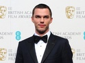 "Nicholas Hoult insists that he and Jennifer Lawrence are ""friends""."