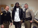 Rapper posts a photograph of himself and police on Twitter.