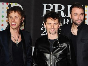 Muse arriving for the 2013 Brit Awards at the O2 Arena, London
