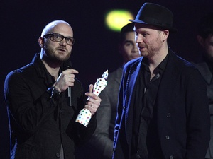 Will Champion and Jonny Buckland (right) of Coldplay collect the award for British Live Act during the 2013 Brit Awards at the O2 Arena, London.
