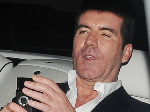 Simon Cowell looking rather worse for wear outside the May Fair hotel for the Penthouse Party, after the live Saturday night 'X Factor' show