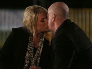 Phil and Sharon kiss.