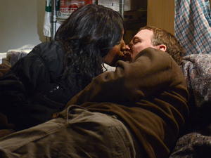 Ian and Denise share a kiss.