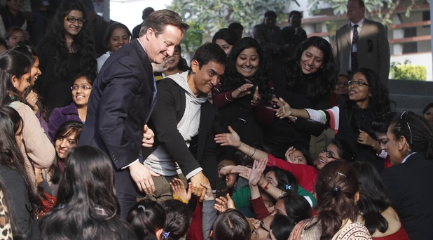 David Cameron and UNICEF ambassador Aamir Khan meet students at the Janaki Devi Memorial College in New Delhi, India