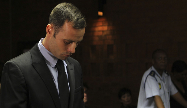 Oscar Pistorius stands in court during his bail hearing at the magistrate court