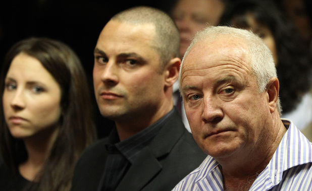 Aimee, Carl and Henke Pistorius watch as Oscar Pistorius walks in during his bail hearing