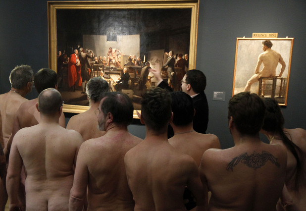"Naked Museum visitors look at pictures of the show ""Nude Men from 1800 to Today"" at the Leopold Museum, Vienna"