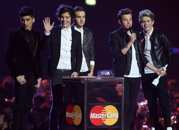 One Direction collects the Global Success Award award during the 2013 Brit Awards at the O2 Arena, London.